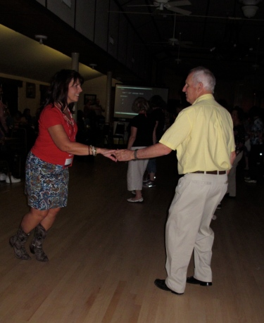 Laurie Pullins on past issue Hearing Loss Magazine line dancing with friend